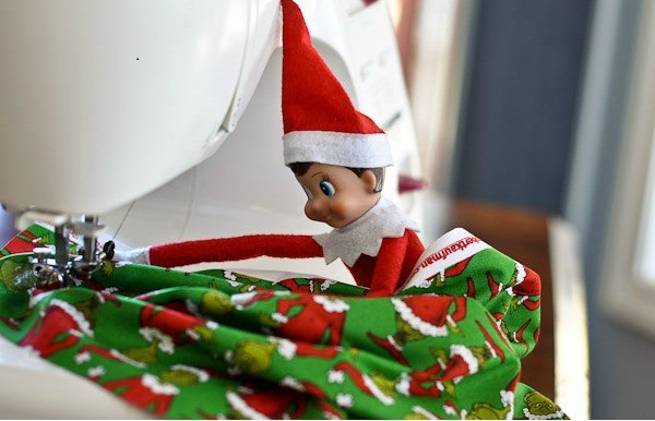elf making curtains photo
