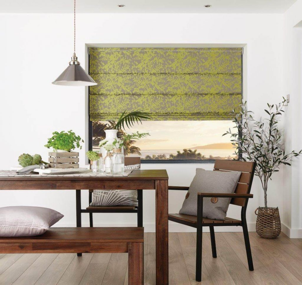Roman blind inside a window recess in a dining room