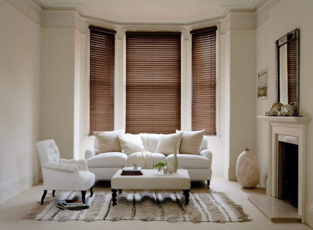 Wooden venetian blinds in a lounge bay window