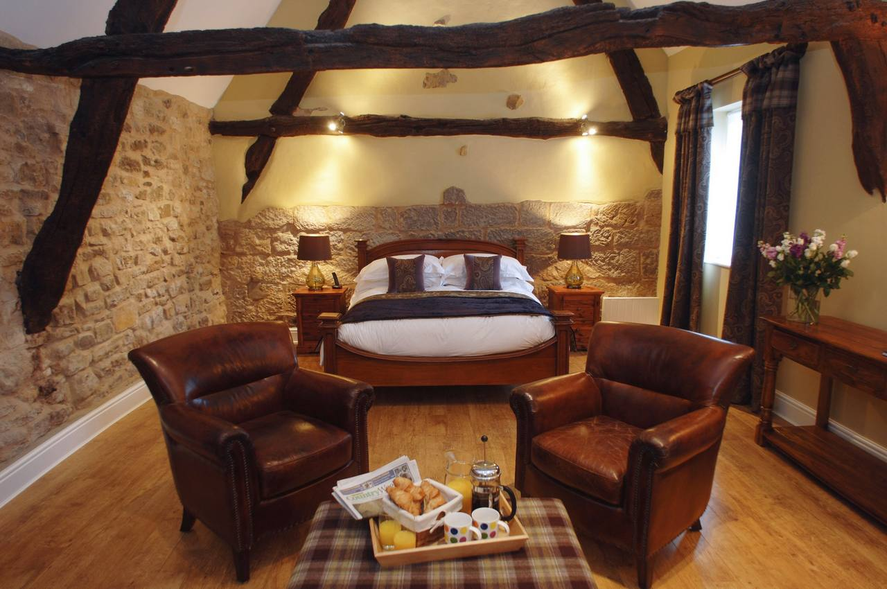 Converion of an historic cruck framed barn in North York Moors into luxury holiday accomodation - master bedroom - copyright Fabric Gallery & Interiors