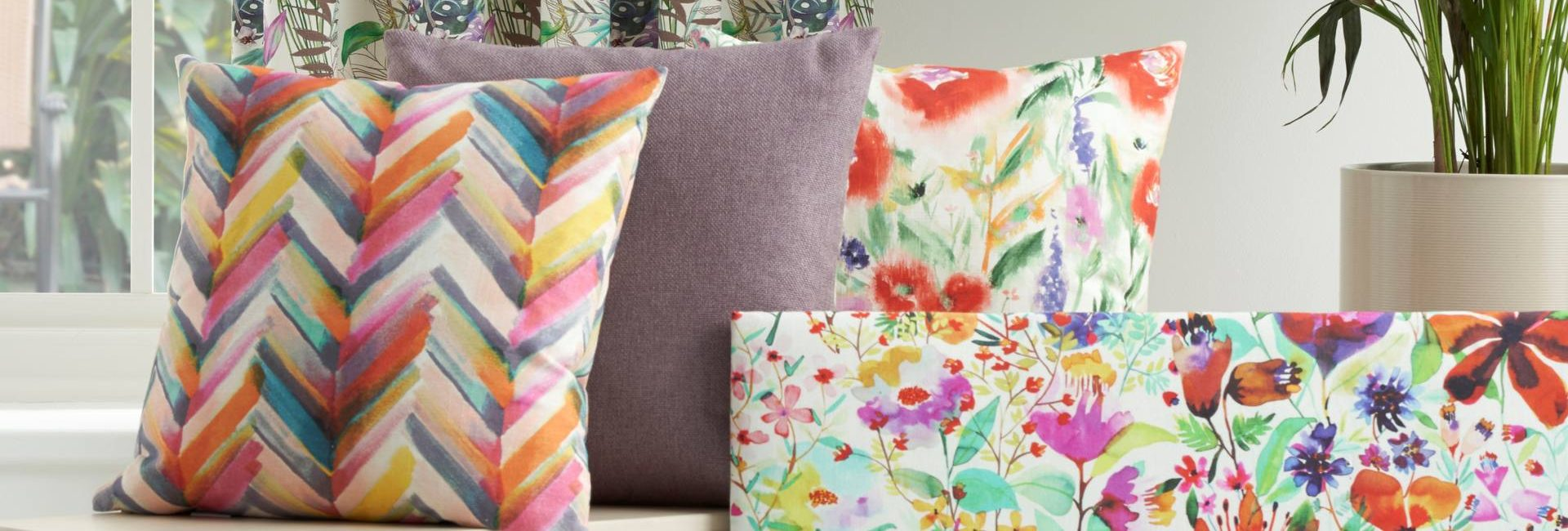 Chess Designs Jardin fabric collection shown as cushions - available from Fabric Gallery and Interiors in Dunnington, York