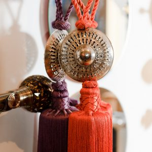 Close up of artisan curtain tie backs from Morocco at Fabric Gallery & Interiors