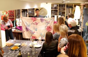Large piece of fabric being shown to customers at Fabric Gallery and Interiors