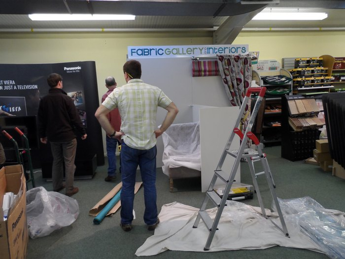 We are rushing to complete our stand before the show opens (everyone seems camera shy!)