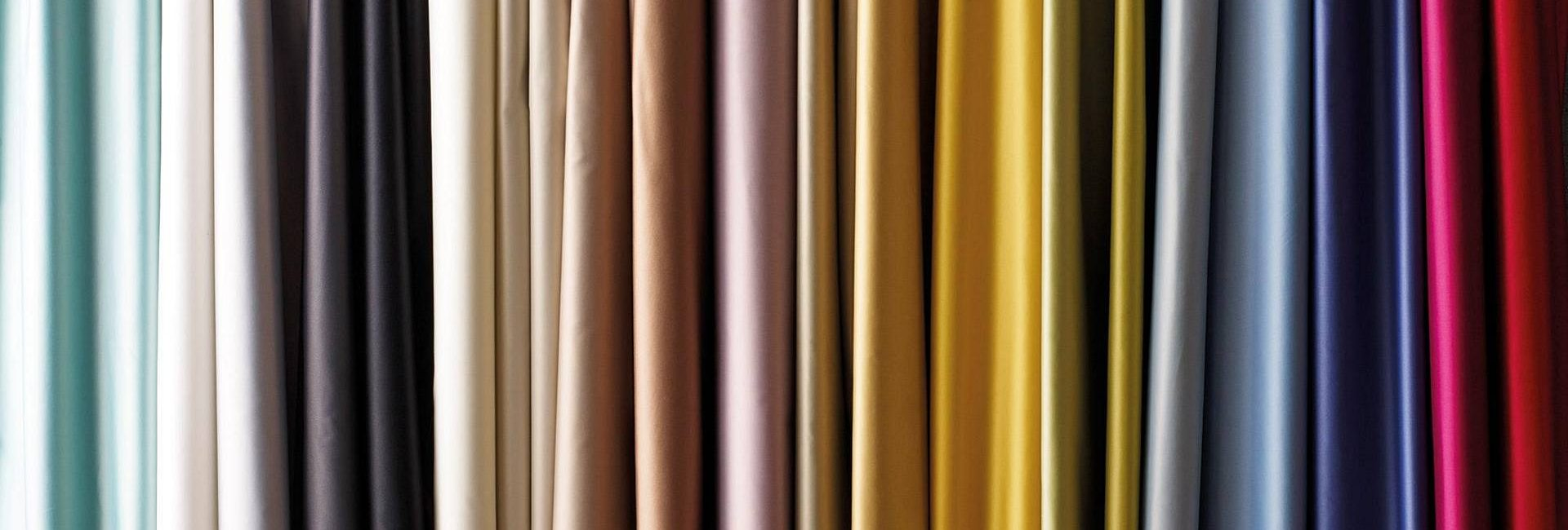 Selection of curtain fabrics in a spectrum of colours by Osborne and Little