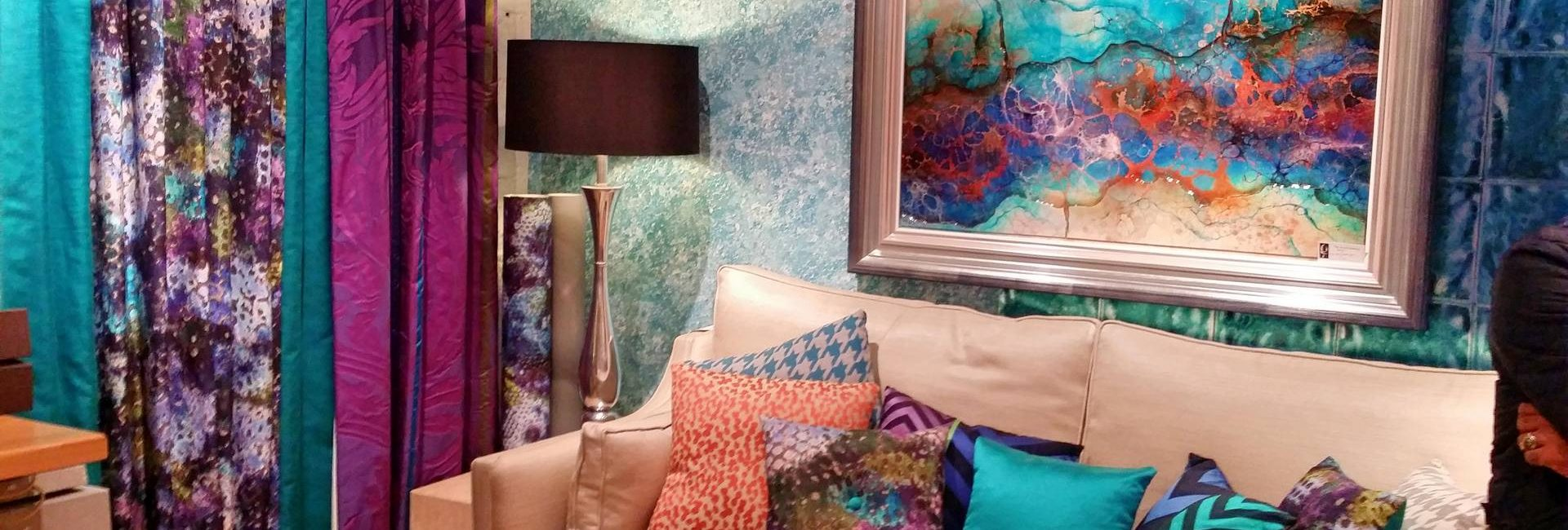 Display area featuring wallpaper, sofa, curtains and coordinated Kerry Darlington artwork at Fabric Gallery and Interiors in York