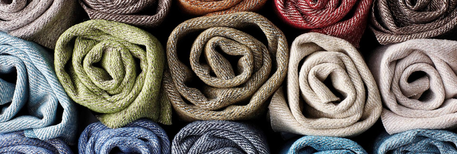 Photo of rolled up fabrics by Osborne and Little from Fabric Gallery and Interiors